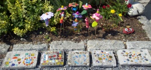 Stepping stones and clay flower art for your garden